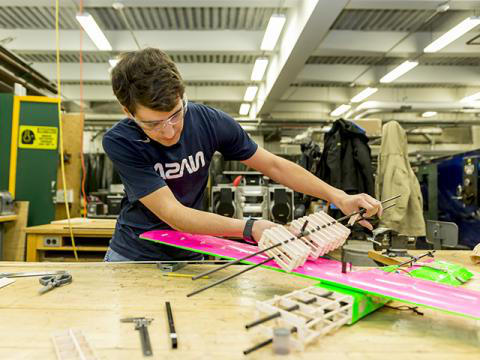 An undergraduate aeronautical engineering student works on the Design, Build, Fly team airplane