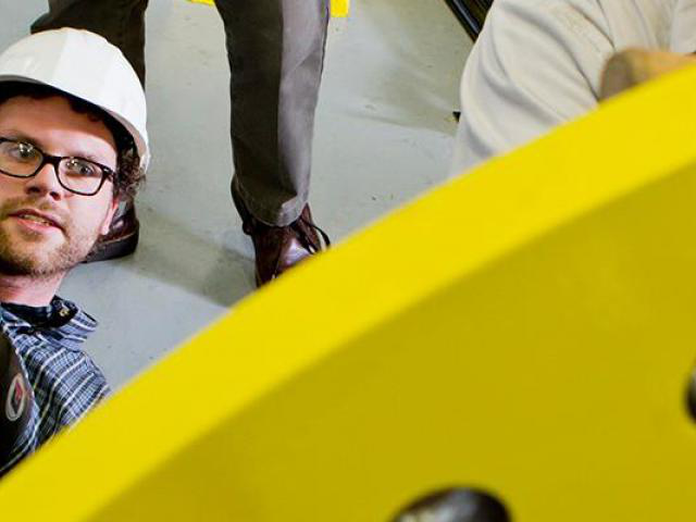 Individuals working on a wind turbine blade